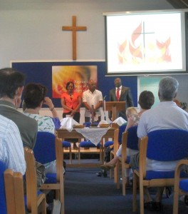 Stephanie, Alfred and their Old Pastor as they were welcomed into KBC membership.